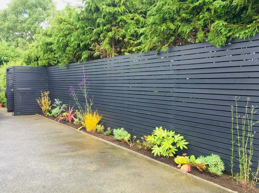 Simple clean lines Good Quality Wood was used for this new fence...looks great when finished in a Sharp Customised Black Paint...